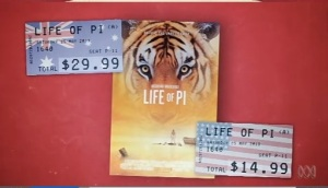 "The relative cost of buying the movie ""Life of Pi"" in Australia and the US (from The Checkout)"